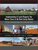 Implementing a Local Property Tax Where There Is No Real Estate Market : The Case of Commonly Owned Land in Rural South Africa, Bell, Michael E. and Bowman, John H., 1558441697